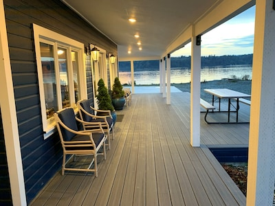 Waterfront deck facing north view with outdoor seating and picnic table