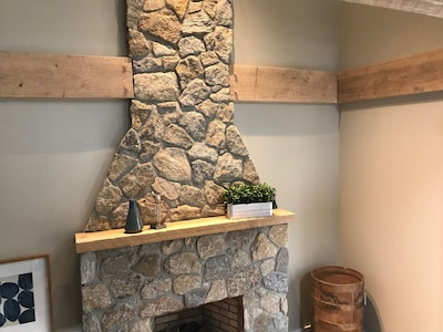 Original field stone fireplace from the 50's, with updates for easy use.