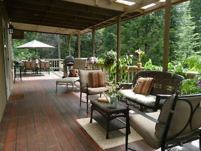 Middle tier featuring cozy large wrap around deck!