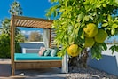 Relax poolside in the dreamy cabana and daybed.
