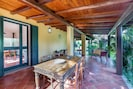 Side patio with outdoor dining table