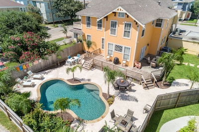 Drone view - house and pool. We have now added a HUGE covered patio. See next pg