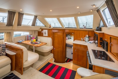 Kitchen area, dinette and forward stateroom, and bath