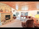 Great room with vaulted ceiling and native  granite rock  gas fireplace