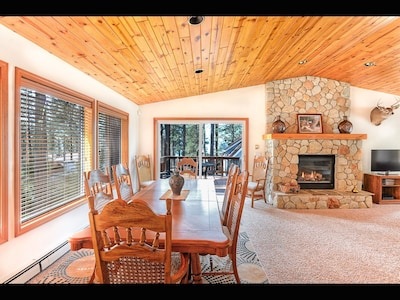 Elegant dining area seating 8, with filtered lakeview