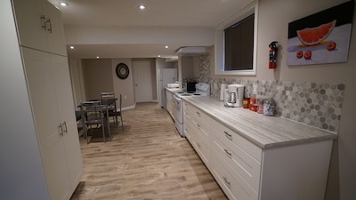 Spacious eat in kitchen with ample cupboard space.