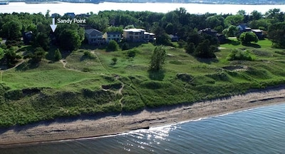 Areal view of the house and the path to a sandy beach right behind the house