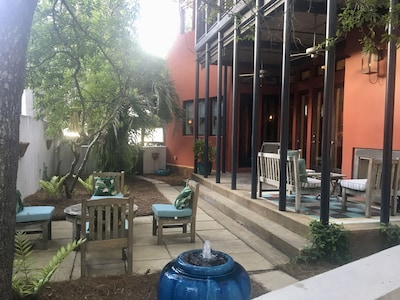 New Orleans style courtyard, patio, fountain & fireplace.