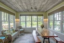 4 season screened porch with heated tile floor
