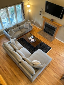 Brand new extra deep couches, super comfortable, plenty of seating and light.