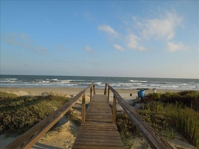 cross bridge from beach house to the beach within less a minute walking distance