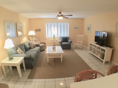 Living room with flat screen cable TV, Netflix and password protected wifi.
