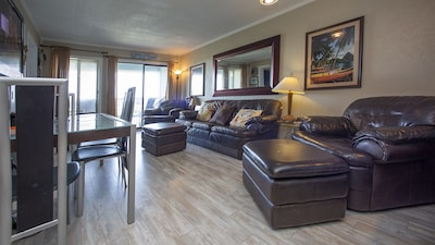 Living/Dining Area with lots of comfortable seating