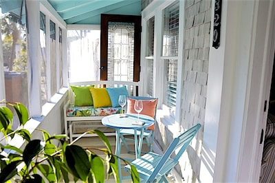 Enjoy sunshine, flowers and breezes. Private screened porch.