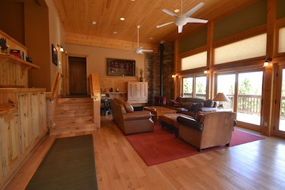 Main Level living room with stereo, flat screen tv dvd, huge deck,