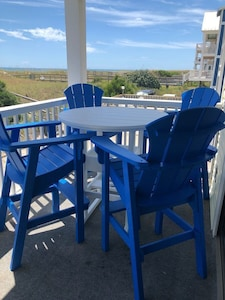 New table and chairs on the balcony overlooking the beach!