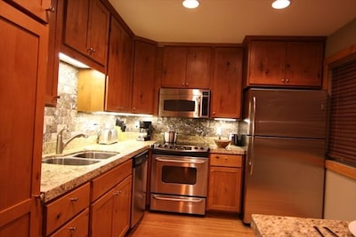 Gourmet Kitchen with granite counters and stone back splash.