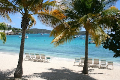 Stunning semi private Cowpet Bay beach is in front of you!