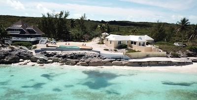 View of the house from the crystal clear water