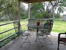 Covered deck overlooking the valley and peach trees