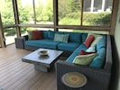 Sectional in screened porch for hanging out or napping to the waves