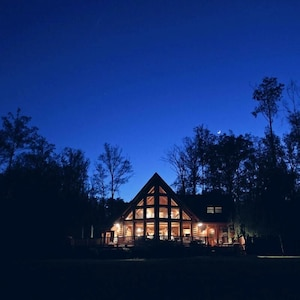 View of Lakeside of the house as seen from the beach during dusk before dark.
