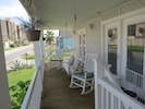 Private balcony has rocking chairs and porch swing.