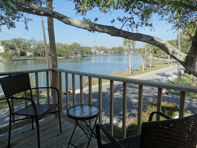 Morning coffee on porch overlooking lake, pelicans, ospreys and eagles flying by