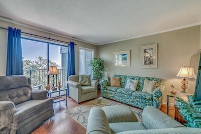 Main living area featuring ocean views, and a sleeper sofa