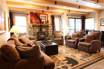 Living room with free standing gas fireplace