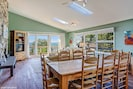 Open dining room with large farmhouse dining table