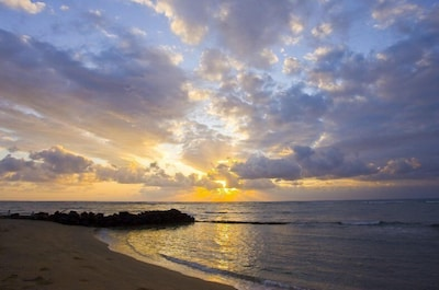 You'll be steps away from gorgeous sandy Waipouli Beach!