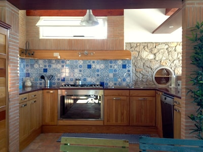 large kitchen fully equipped, decorated with Vietri majolica