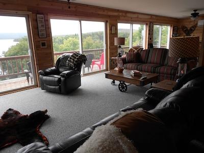 Stunning views through 4 huge sliders, beautiful wood interior.