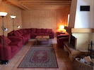 Spacious lounge with log fire