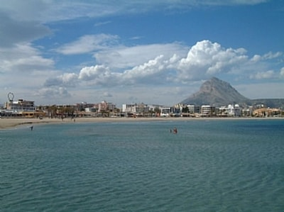 Javea beach during the day and the Montgo mountain
