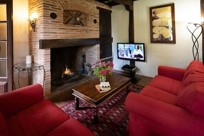 Cosy living room area in front of open fire