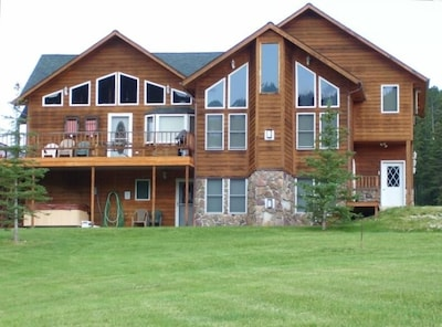 Hilltop Lodge sits on 3 acres with a wrap-around deck.  Beautiful views!