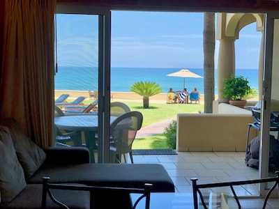 View from inside condo towards pool/ocean