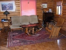 Living Room Area w/ old Secretary that is now Upstairs