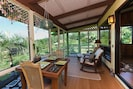 From the lanai you can plan your day, or wait for the mangos to ripen.