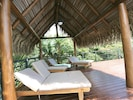 Relax in the shade under the large palapa on the pool deck.