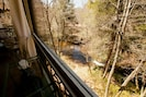 Hear and see the rushing waters below as you relax on the screen porch