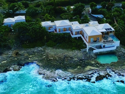Aerial view of the main villa and cottage located on a large private lot