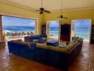 Main living room with an amazing view of the Caribbean Sea