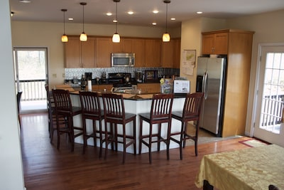 Large island, stainless appliances, breakfast nook, dining room
