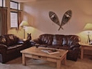 leather furniture in living room sitting area.
