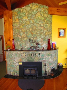 Cedar tree and fireplace are the center of the home