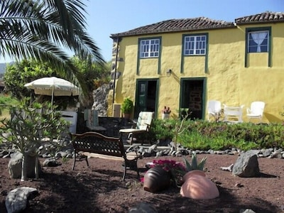 Enjoy the patios and ornamental garden - a place to sit for every occasion.