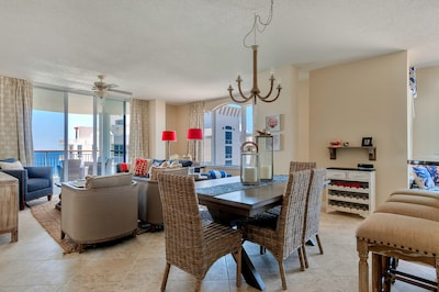 Enjoy your vacation in this stunning penthouse condo with views from every room